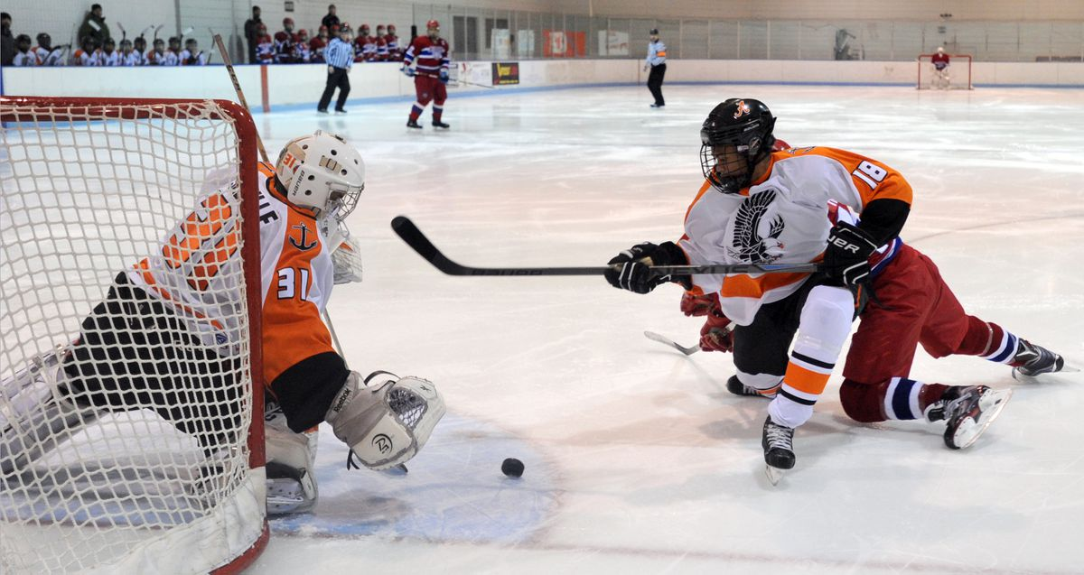 West goaltender Isaiah Saville, left, and teammate Cyril Boots stop an East scoring chance during first-period action on Dec. 8, 2015, at Ben Boeke Ice Arena. (Erik Hill / ADN archive 2015)