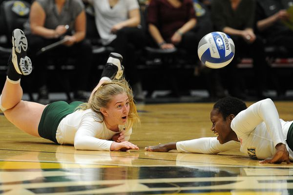 Ellen Floyd and Chrisalyn Johnson, of the UAA Seawolves, go for the dig against the Western Washington Vikings in volleyball action at the UAA Alaska Airlines Center on Thursday, Oct 18, 2018 in Anchorage, AK. (Bob Hallinen / ADN)