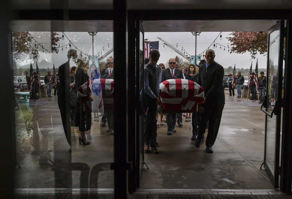 The casket containing Army Spc. Gabriel D. Conde is carried to the inside of the church during a memorial service at LifeBridge church on May 12, 2018 in Longmont, Colo. (Washington Post photo by Ricky Carioti)