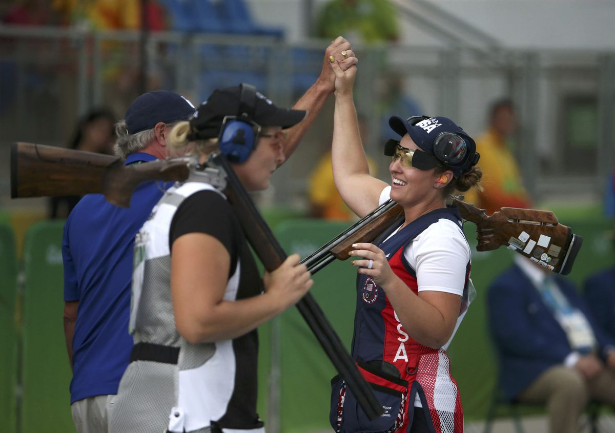 Corey Cogdell-Unrein of Eagle River, right, celebrates after winning the bronze medal in women's trapshooting Sunday at the Rio Olympics. (Edgard Garrido / Reuters)