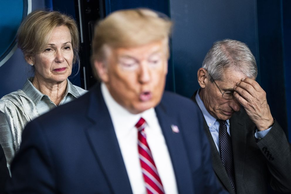White House coronavirus response coordinator Deborah Birx and National Institute of Allergy and Infectious Diseases Director Anthony Fauci listen as President Trump speaks at a coronavirus briefing at the White House on March 20. (Washington Post photo by Jabin Botsford)`