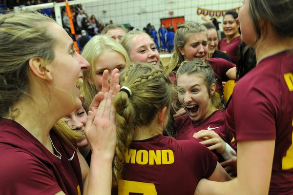 The Dimond Lynx celebrate their win over the Bartlett Golden Bears in the 4A State Volleyball Championship game at West High in Anchorage, Alaska on Saturday, Nov.1, 2017. The
