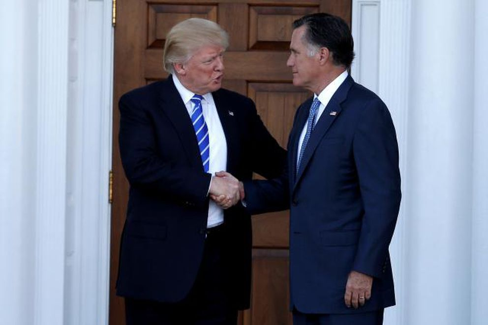 U.S. President-elect Donald Trump shakes hands with former Massachusetts Governor Mitt Romney after their meeting at the main clubhouse at Trump National Golf Club in Bedminster, New Jersey, U.S., November 19, 2016. REUTERS/Mike Segar