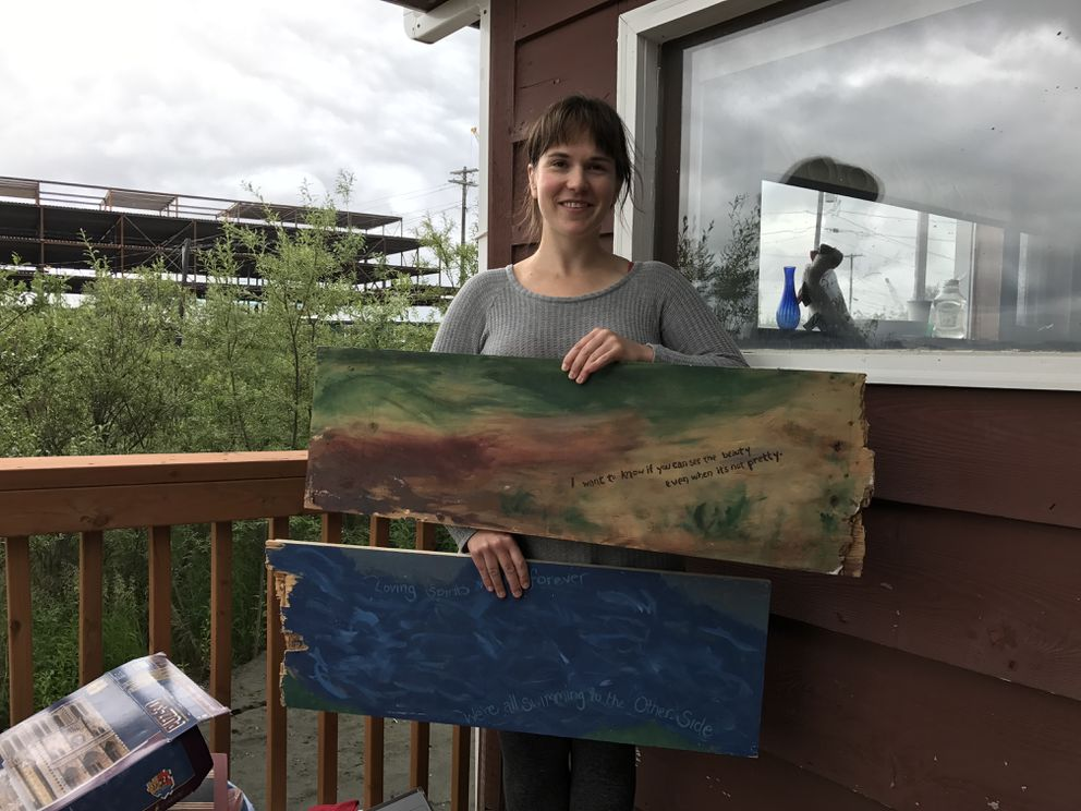 Chelsea Gulling with painted panels from the old Jesuit volunteer house. (Lisa Demer / Alaska Dispatch News)