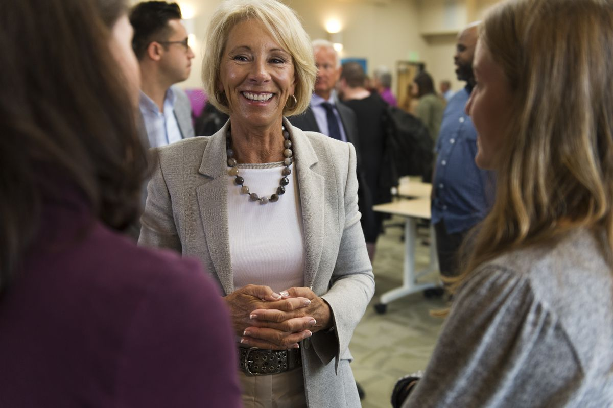 U.S. Secretary of Education Betsy DeVos talks to Anne Zink, left, and her daughter Isabelle, 14, during a visit to Mat-Su Central School on August 26, 2019. Isabelle is a student at the school. (Marc Lester / ADN)