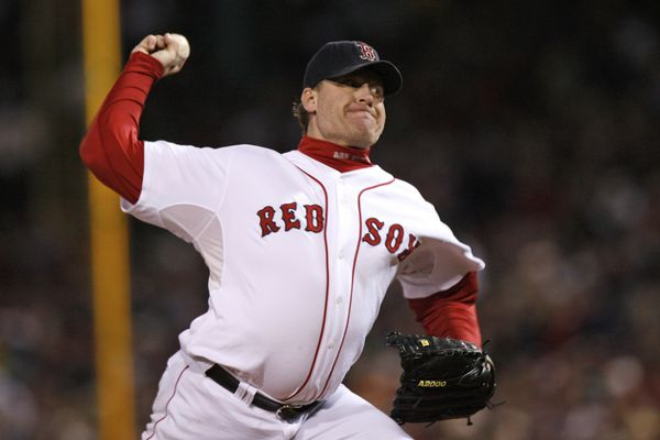 FILE - In this Oct. 25, 2007, file photo, Boston Red Sox's Curt Schilling pitches against the Colorado Rockies in Game 2 of the baseball World Series at Fenway Park in Boston. Like many baseball writers, C. Trent Rosecrans viewed the Hall of Fame vote as a labor of love. The results of the 2021 vote will be announced Tuesday, Jan. 26, 2021, and Rosecrans was not alone in finding the task particularly agonizing this time around. With Schilling's candidacy now front and center — and Barry Bonds and Roger Clemens still on the ballot as well — voters have had to consider how much a player's off-field behavior should affect his Hall of Fame chances. (AP Photo/Kathy Willens, File)