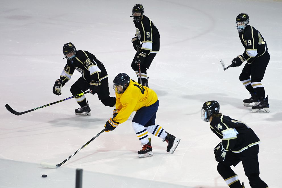 Bartlett forward Jonathan Hamner is surrounded by South Anchorage defenders during the Wolverines' 13-1 victory over the Golden Bears at Ben Boeke on Tuesday. (Bill Roth / ADN)