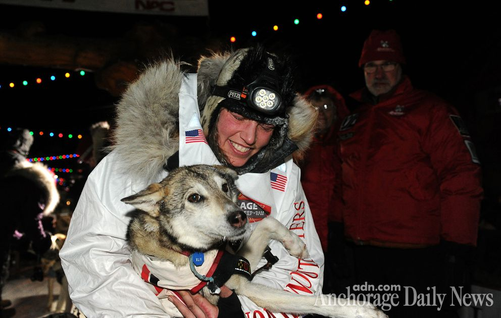 Aliy Zirkle smiles with her lead dog after finishing in second place behind race winner Dallas Seavey in the Iditarod Trail Sled Dog Race in 2014. (ADN archive)