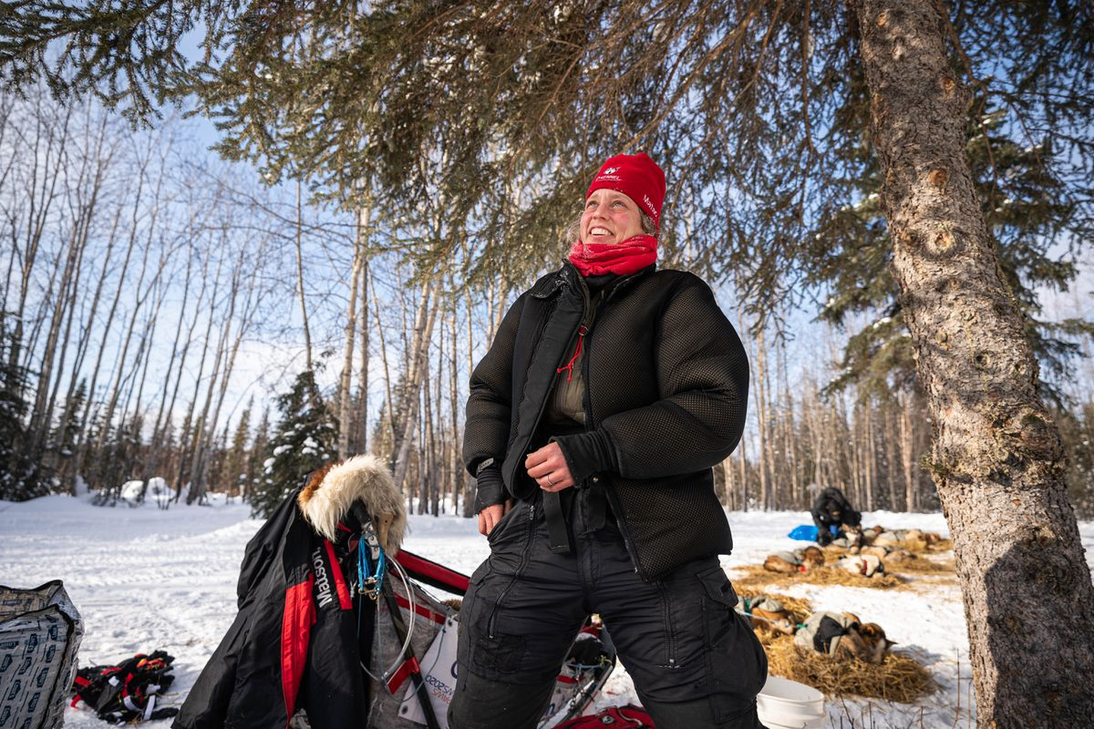 Aliy Zirkle rests with her team in Ophir on Wednesday, March 11, 2020 during the Iditarod Trail Sled Dog Race. (Loren Holmes / ADN)