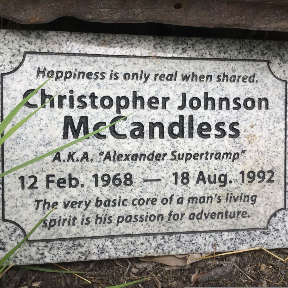 This July 2018 photo shows a granite memorial placed near the abandoned bus where Christopher McCandless starved to death in 1992 off the Stampede Trail near Healy. (Pamela Szatanek via AP)