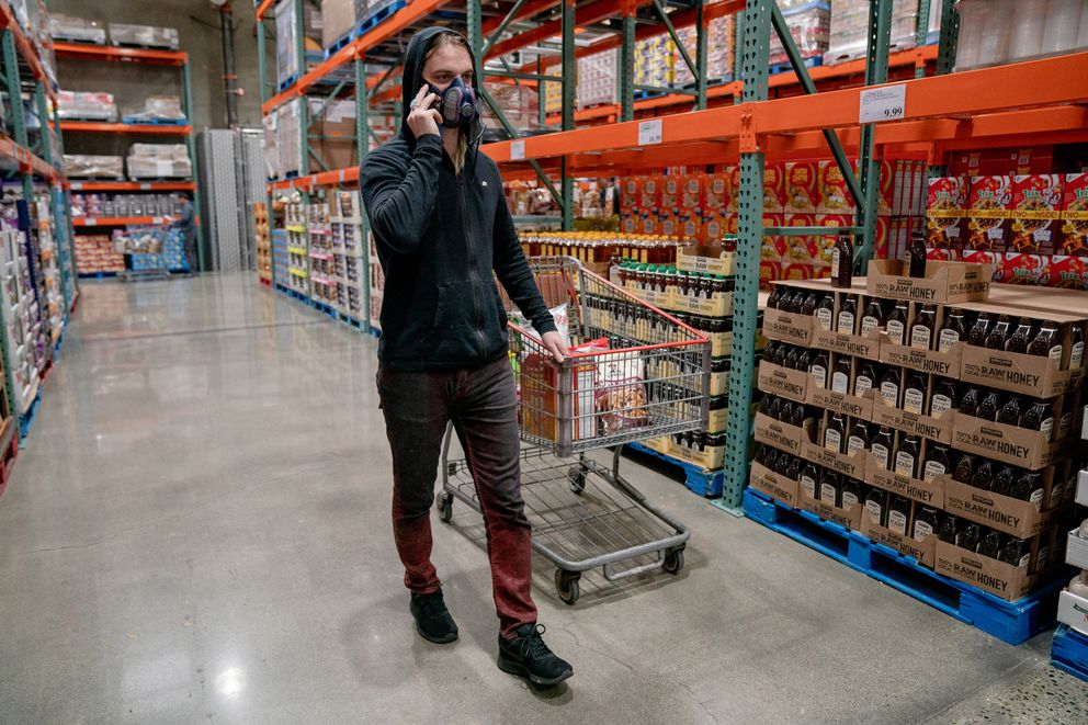 Kingsley Northcott shops for nonperishable groceries at Costco on Sunday, March 1, 2020, in Kirkland, Washington, where officials are monitoring a possible coronavirus outbreak. Photo for The Washington Post by Jovelle Tamayo