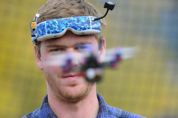Chris Rush tests a flight controller while competing in the Alaska Drone Racing League's final races of the season at Jim Creek RC Park located next to the Knik River Public Use Area entrance on Sunday, Sept. 18, 2017. (Bill Roth / Alaska Dispatch News)