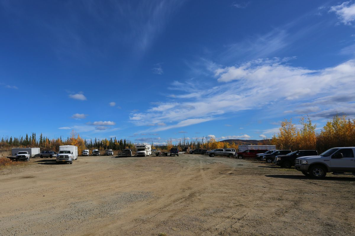 Full parking lots and gravel pits are the norm wherever ATV access is available for hunting, as was the case near Tok in September. (Phot by Steve Meyer)