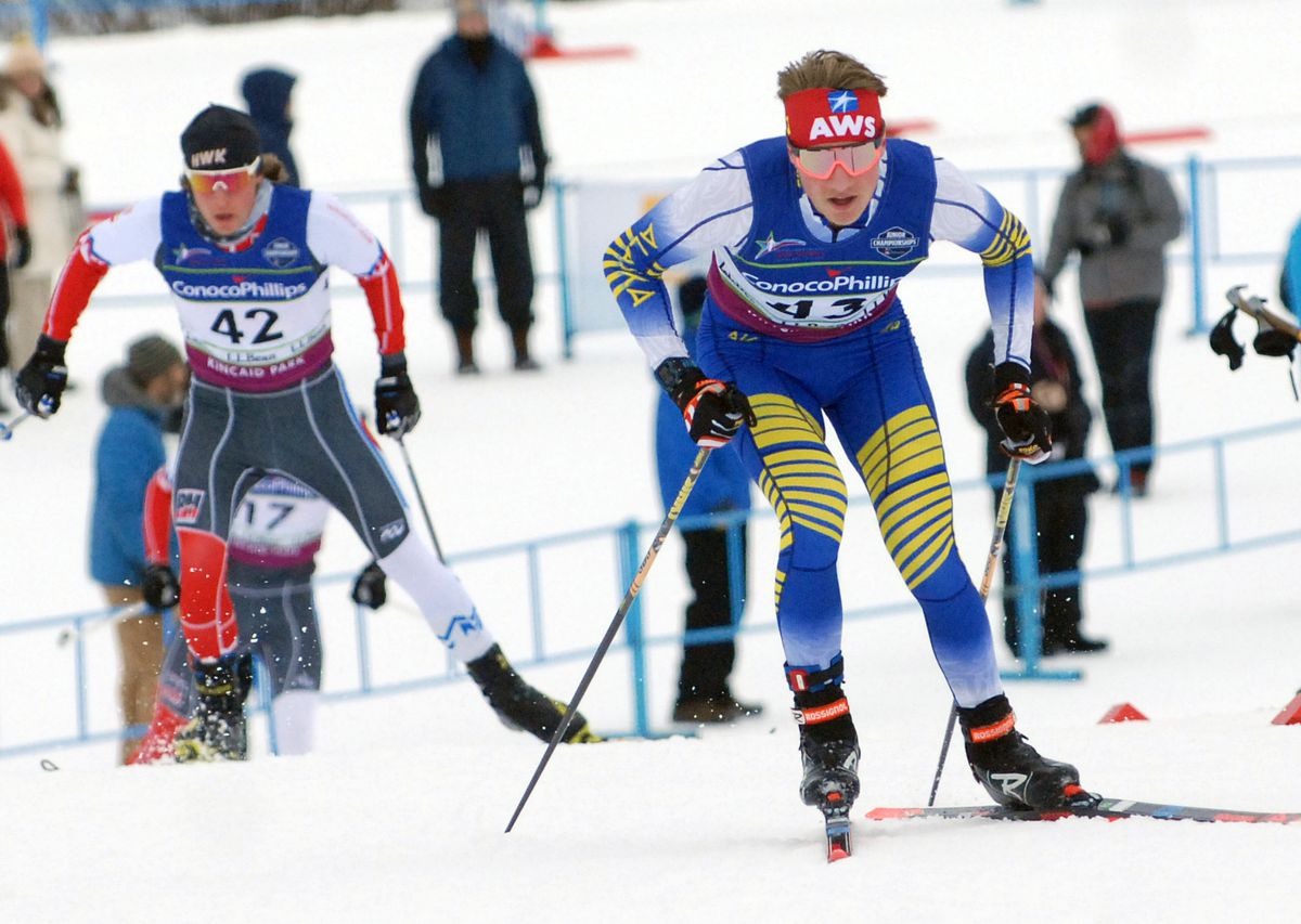 Alaska's Gus Schumacher, right, races past Colorado's Logan Moore during the men's U20/U18 10-kilometer freestyle race during the U.S. Cross-Country Junior Nationals at Kincaid Park on Monday, March 11, 2019. (Matt Tunseth / ADN)