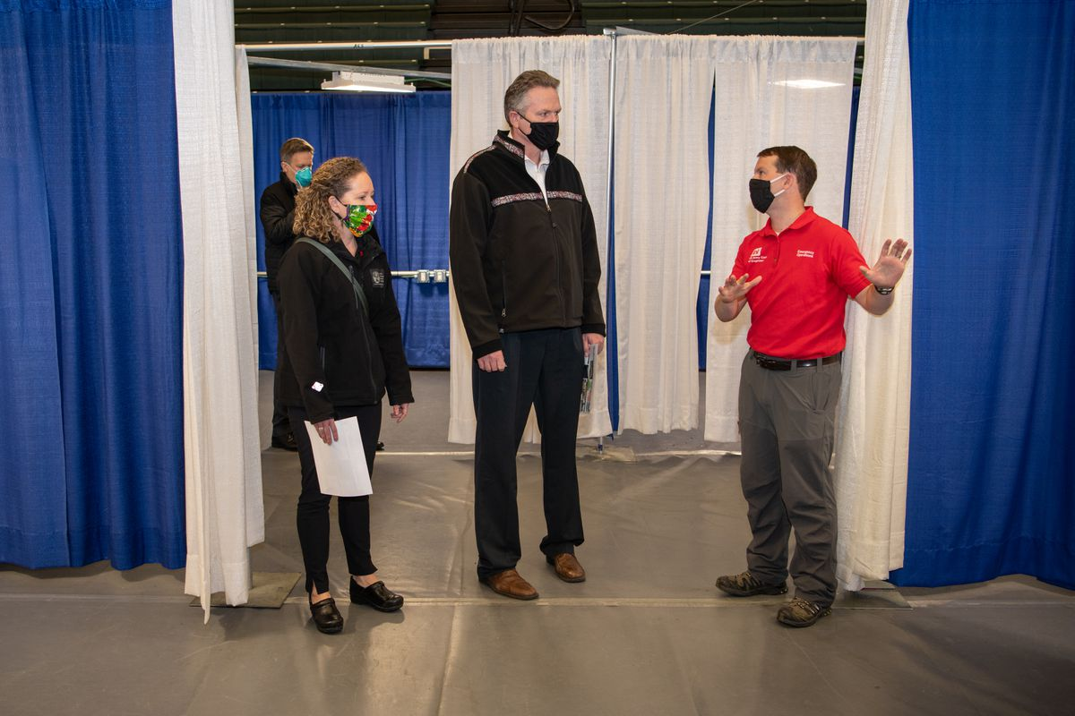 Alaska Republican Gov. Mike Dunleavy, center, tours an overflow treatment facility at the Alaska Airlines Center in Anchorage in April. (Photo by Gov. Mike Dunleavy's office)
