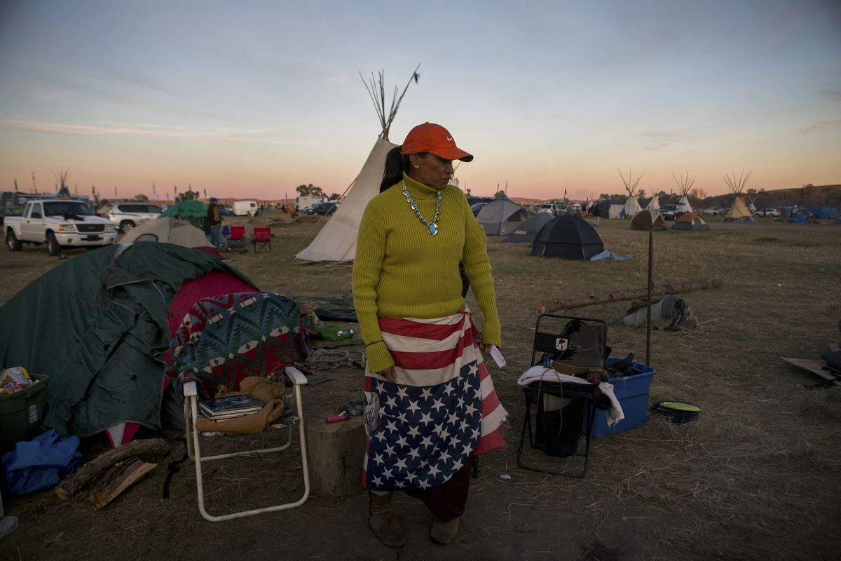 Stacey Alkire of the Standing Rock Sioux Tribe, who has been at the campsite set up to protest the Dakota Access oil pipeline for five weeks, near Cannon Ball, N.D., on Saturday. (Kristina Barker / The New York Times)