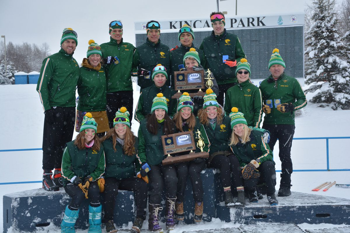 Members of Service High's ski team, which swept the boys and girls team titles Saturday at the state cross-country ski championships at Kincaid Park, pose with their trophies and medals. At the far right is coach Jan Buron. (Photo by Laarni Power)