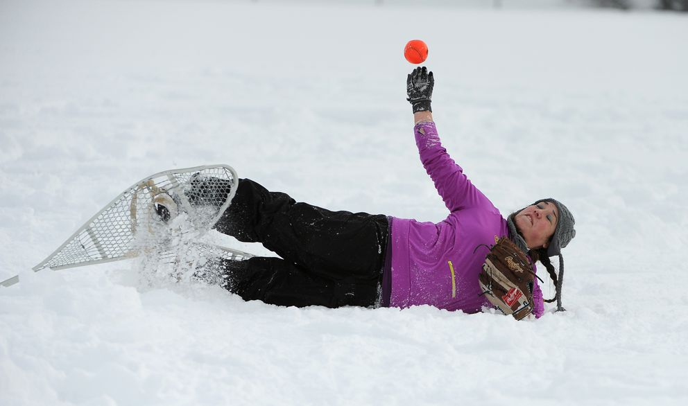 Fielder Stephanie Dush throws the ball in during the Fur Rondy snowshoe softball tournament at Kosinski Fields in Anchorage, Alaska on Saturday, Feb. 25, 2017. (Bob Hallinen / Alaska Dispatch News)