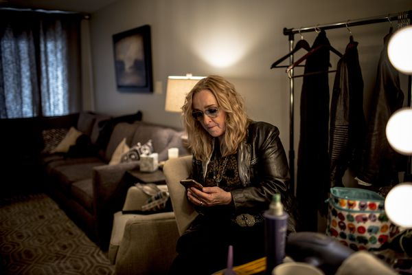 Melissa Etheridge, who said she used medical marijuana during treatment for breast cancer and is now starting her own cannabis business aimed at people with pain from arthritis, sports injuries or other conditions, on her phone before a performance in Nashville, Tenn., March 20, 2017. Because federal law takes precedence, flying in possession of marijuana is barred. Enforcement, however, is not a priority for screeners at the airport. (Andrea Morales/The New York Times)
