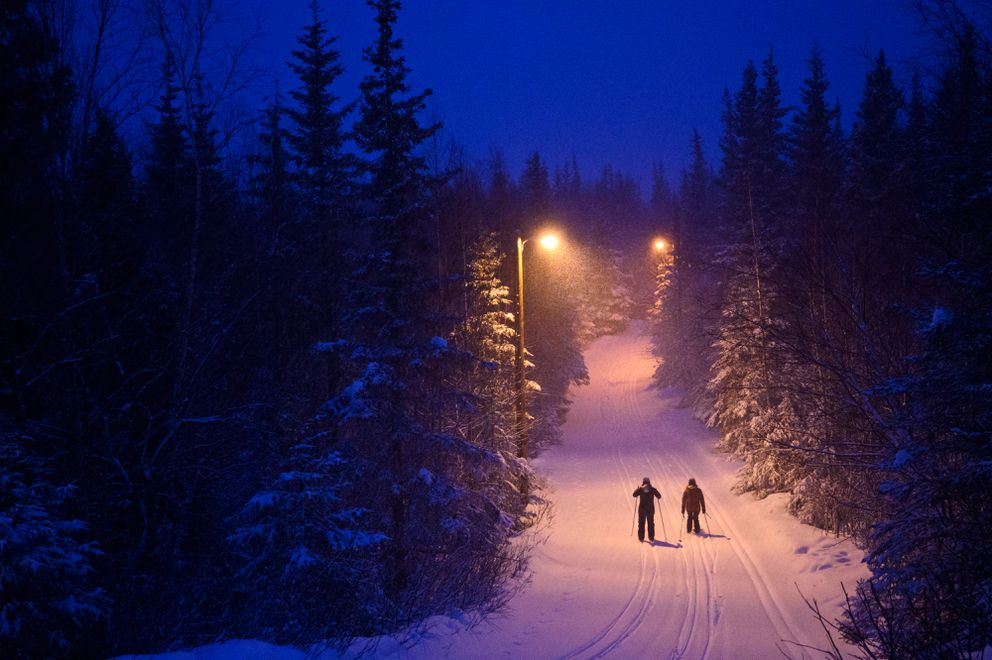 Skiers glide through new snow on the Hillside Ski trails on Wednesday evening March 10, 2021. (Marc Lester / ADN)