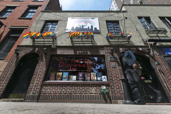 FILE - In this May 29, 2014 file photo, a man passes The Stonewall Inn in New York's Greenwich Village. The bar was the site of the Stonewall uprising that started on June 28, 1969 and galvanized the Gay Rights Movement. June 2019 Pride Month marks the 50th Anniversary of the Stonewall uprising, with events that commemorate that moment and its impact through the last five decades. (AP Photo/Richard Drew, File)