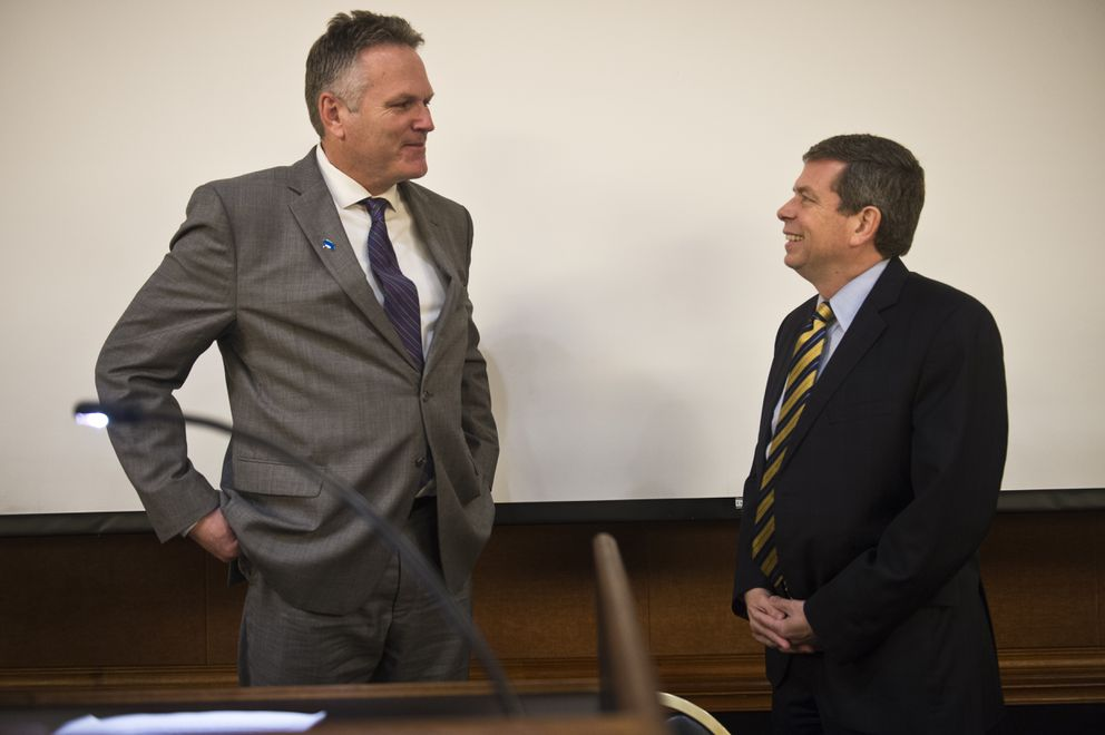 Mike Dunleavy, left, talks with Mark Begich before the debate begins.  (Marc Lester / ADN)