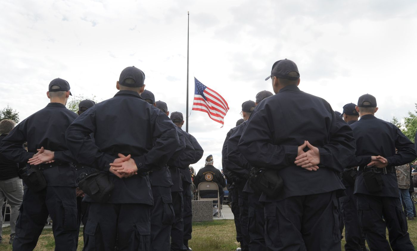 Members of the Alaska Military Youth Academy listen to a speech during the ceremony on the Park Strip. (Anne Raup / ADN)