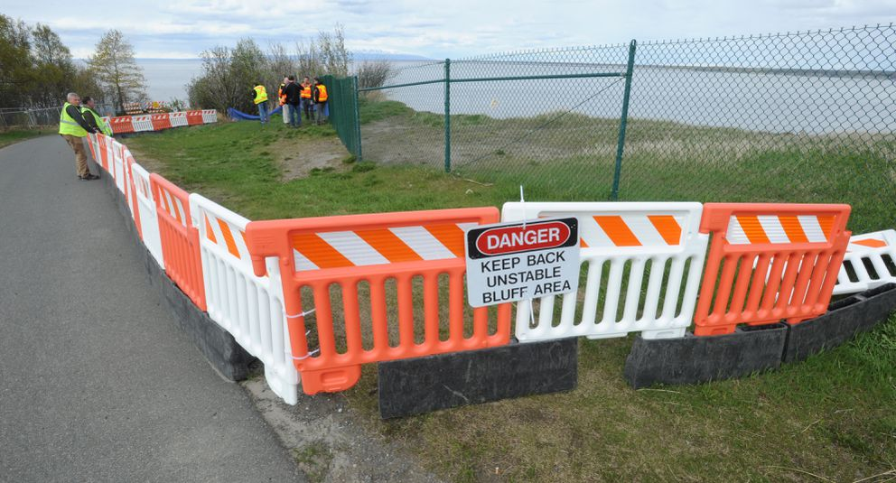 Officials look at earthquake damage to the already unstable Point Woronzof bluff that has been losing ground to erosion for years. Monday, May 13, 2019. (Bill Roth / ADN)