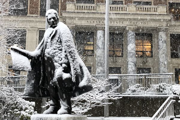 The statue of William Henry Seward in front of the Alaska State Capitol is seen covered in snow Thursday, Jan. 30, 2020 in Juneau. (James Brooks / ADN)