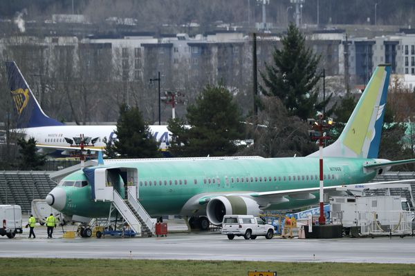 Workers walk near a Boeing 737 Max airplane being built for Oman Air, Wednesday, Dec. 11, 2019, at Renton Municipal Airport in Renton, Wash. The chairman of the House Transportation Committee said Wednesday that an FAA analysis of the 737 Max performed after a fatal crash in 2018 predicted