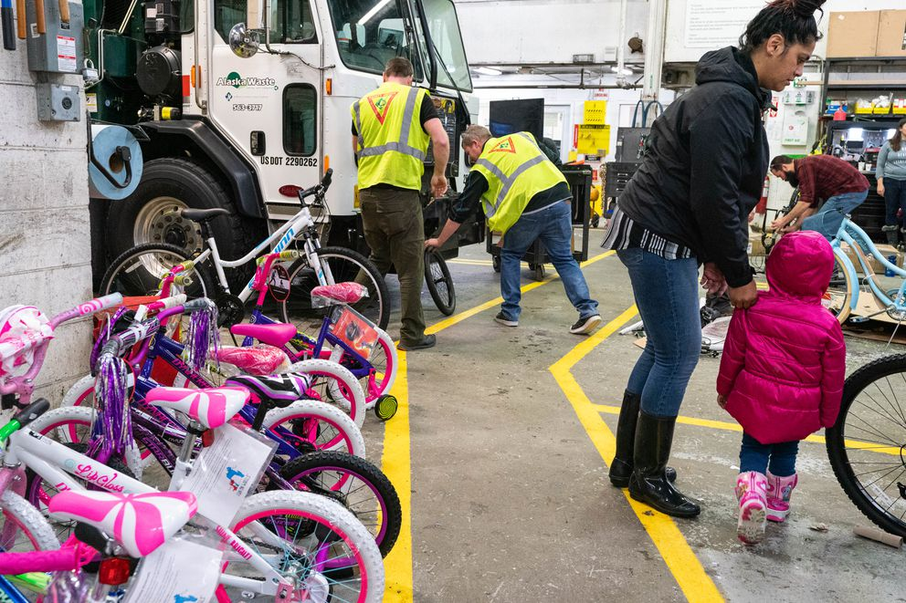 Alaska Waste employees raised money to purchase 77 bicycles, which will be distributed to families in need through the Salvation Army. (Loren Holmes / ADN)