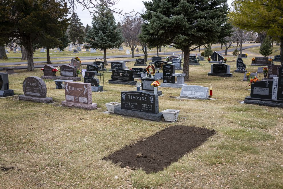 Fresh soil at Mitchell's Graceland Cemetery outlines the gravesite of longtime coach Buck Timmins, who died of covid-19 on Nov. 16. (Photo for The Washington Post by KC McGinnis)