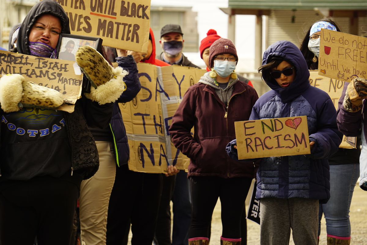 Protesters in Utqiaġvik hold signs calling for an end to systemic racism on Saturday, June 6, 2020. (Photo by Kelly Forster)