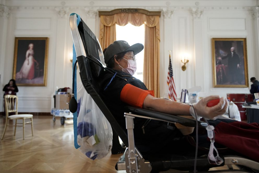 Sugin Quang donates at a blood drive hosted by the Richard Nixon Presidential Library to help meet the urgent demand for donations amid the coronavirus outbreak across the United States in Yorba Linda, Calif., Tuesday, March 31, 2020. (AP Photo/Chris Carlson)