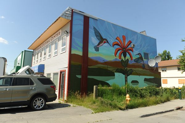 """The """"Picaflores"""" mural painted by Linda Infante Lyons graces the side of the Mountain View Hispanic Cultural Center in Anchorage, AK on Saturday July 7, 2018. (Bob Hallinen / ADN)"""
