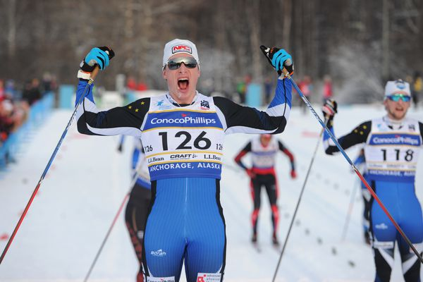 Tyler Kornfield of Anchorage celebrates winning a national championship in the 30K classic event at the Kincaid Park on Sunday, Jan. 7, 2018. Fellow APU skier Eric Packer, right, finished second at the U.S. Cross Country Skiing Championships. (Bill Roth / ADN)