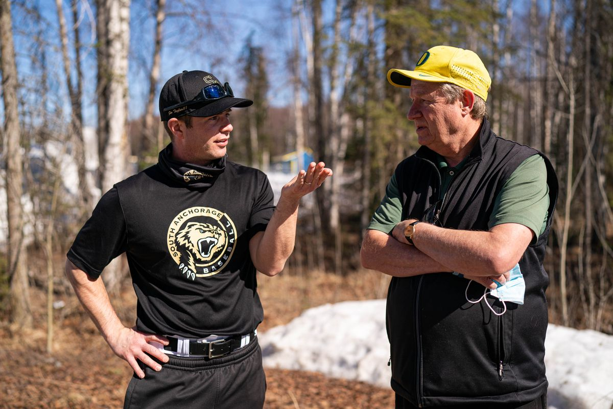 Taylor Nerland, left, talks with his father Steve Nerland on Saturday, April 24, 2021 before a baseball game at Bartlett High School. Taylor is the South Anchorage High School baseball coach, and his dad is a former coach at Service High. Taylor is about to eclipse his dad's winning record. (Loren Holmes / ADN)