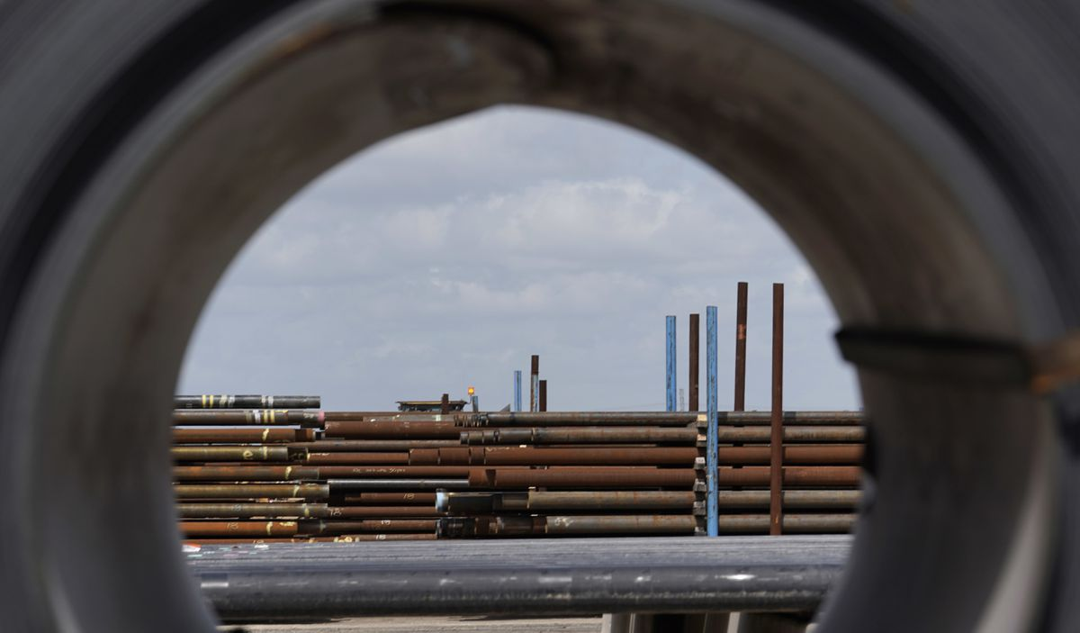 Steel pipes are seen through a roll of steel at the Borusan Mannesmann Pipe manufacturing facility in Baytown, Texas. (AP Photo/David J. Phillip, File)
