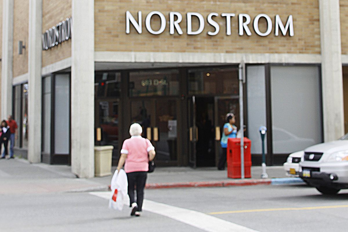 In this Aug. 12, 2009 photo, people walk past the Nordstrom store in Anchorage, Alaska. Nordstrom is expected to report quarterly earnings after the market close Thursday, Aug. 13, 2009.(AP Photo/Al Grillo)