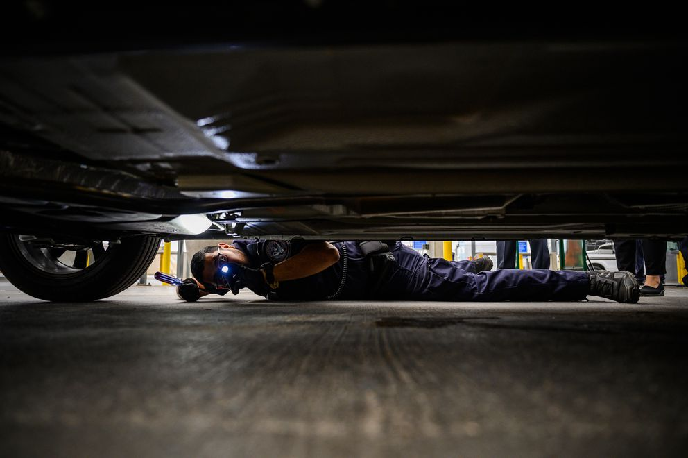CBP officer Jose Ayala searches a vehicle at a secondary checkpoint at San Ysidro in San Diego in June 2019. (Washington Post photo by Salwan Georges)