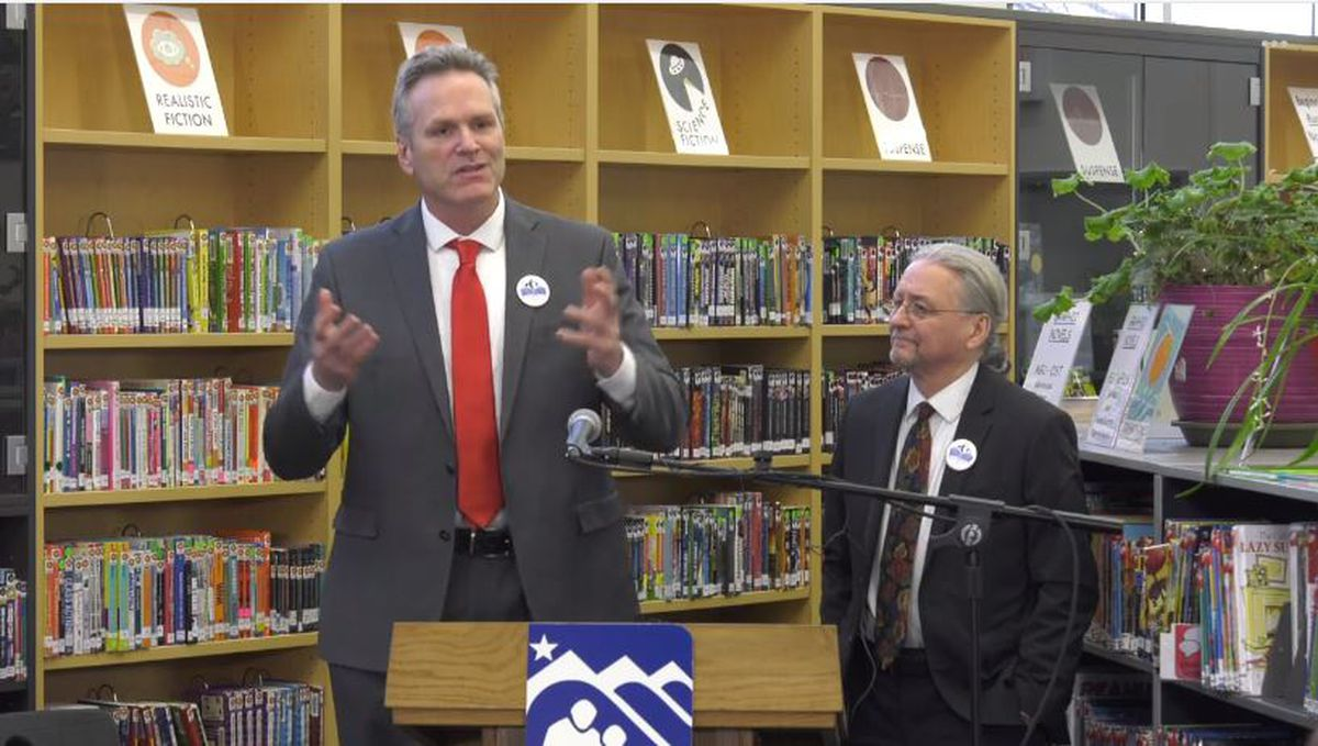 Gov. Mike Dunleavy, left, is seen at Turnagain Elementary School on Jan. 15, 2020 with Senate Minority Leader Tom Begich, D-Anchorage, as the pair announce agreement on bipartisan legislation intended to improve youth reading ability. (From video by Alaska governor's office)