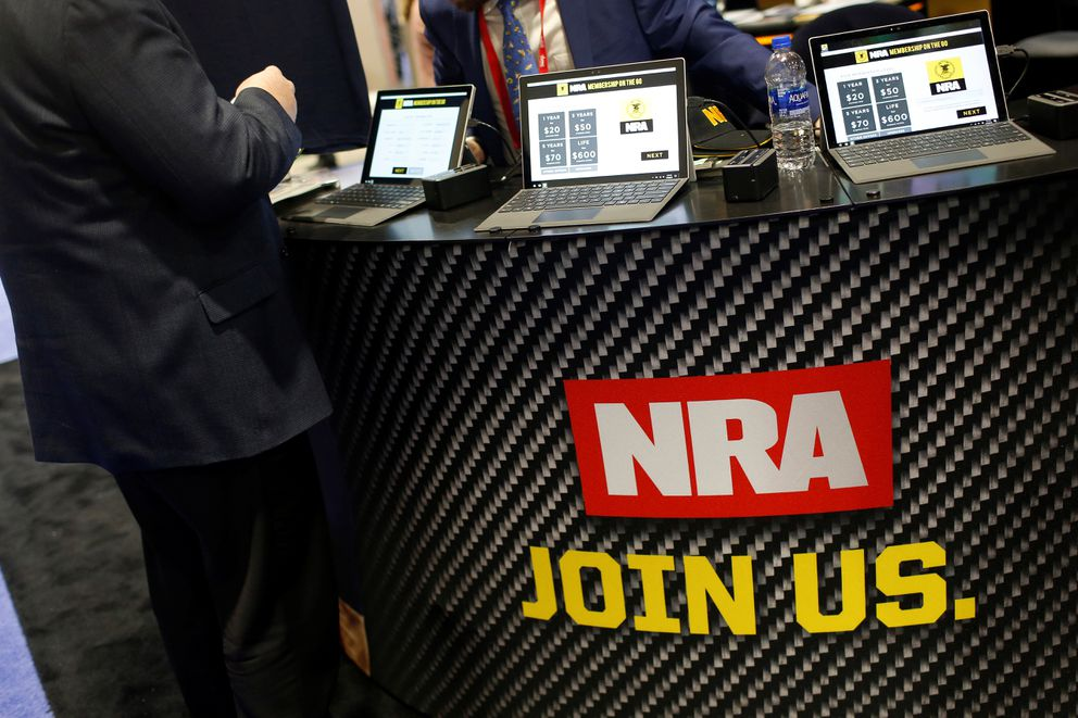 People sign up at the booth for the National Rifle Association (NRA) at the Conservative Political Action Conference (CPAC) at National Harbor, Maryland, U.S., February 23, 2018. REUTERS/Joshua Roberts