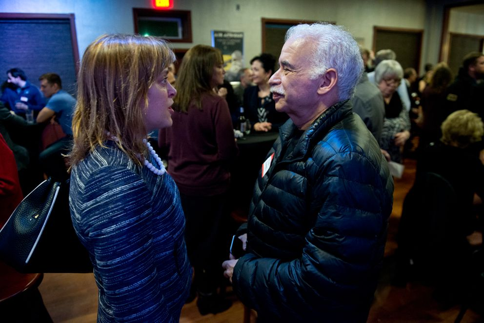 Sen. Mia Costello talks with lobbyist Frank Bickford at a Republican fundraiser in an event hall at Hangar on the Wharf in Juneau on Jan. 16, 2017. (Marc Lester / ADN archive)