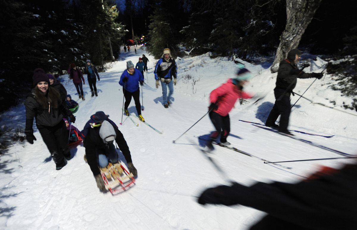 People ski and walk the Mize Loop at last year's inaugural Solstice Tour of Trees at Kincaid Park. (Bill Roth / ADN archive 2016)