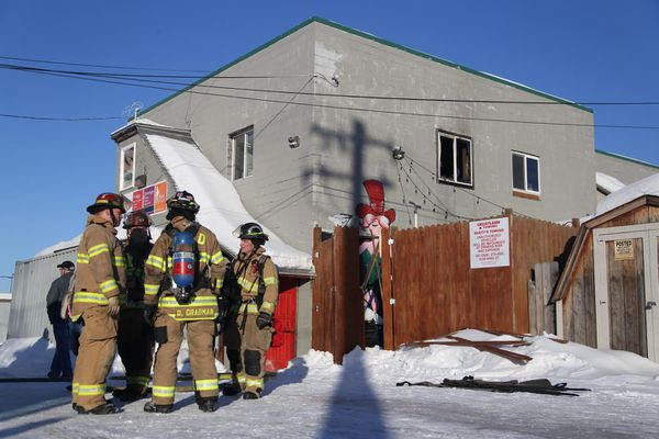 Anchorage firefighters brought a fire on the second floor of Mad Myrna's bar, on Fifth Avenue, under control in about 20 minutes on Wednesday, March 1, 2017. (Rugile Kaladyte / Alaska Dispatch News)