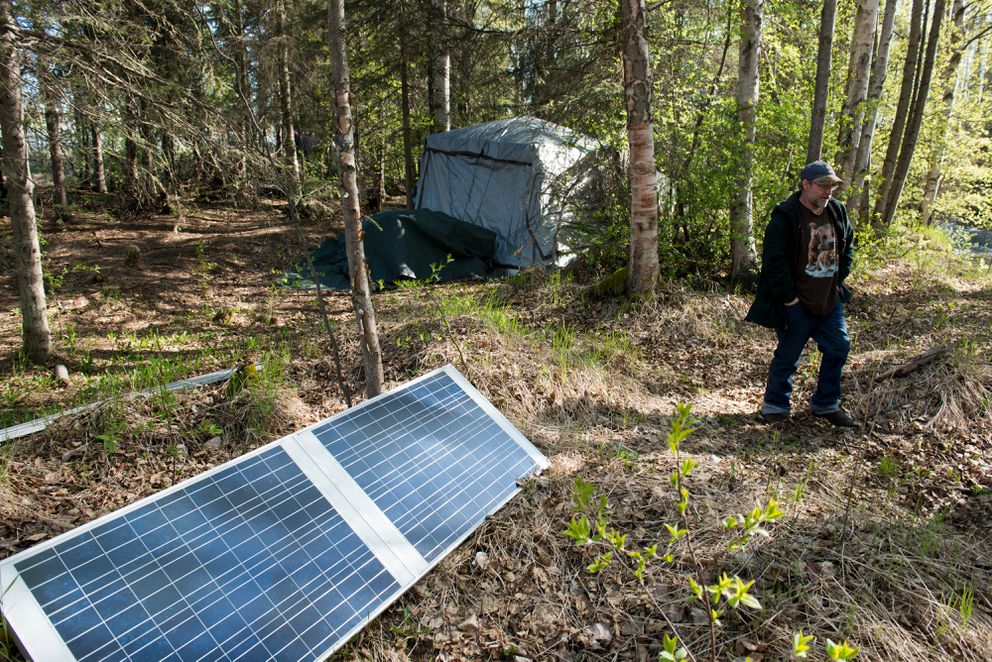 Solar panels charge batteries that power lights and charge devices in Matthew Strametz's camp on May 15. (Marc Lester / Alaska Dispatch News)
