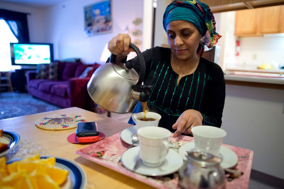 Zabeeba Mohamad, 41, pours tea at home in Fairview on Jan. 30, 2017. (Marc Lester / Alaska Dispatch News)