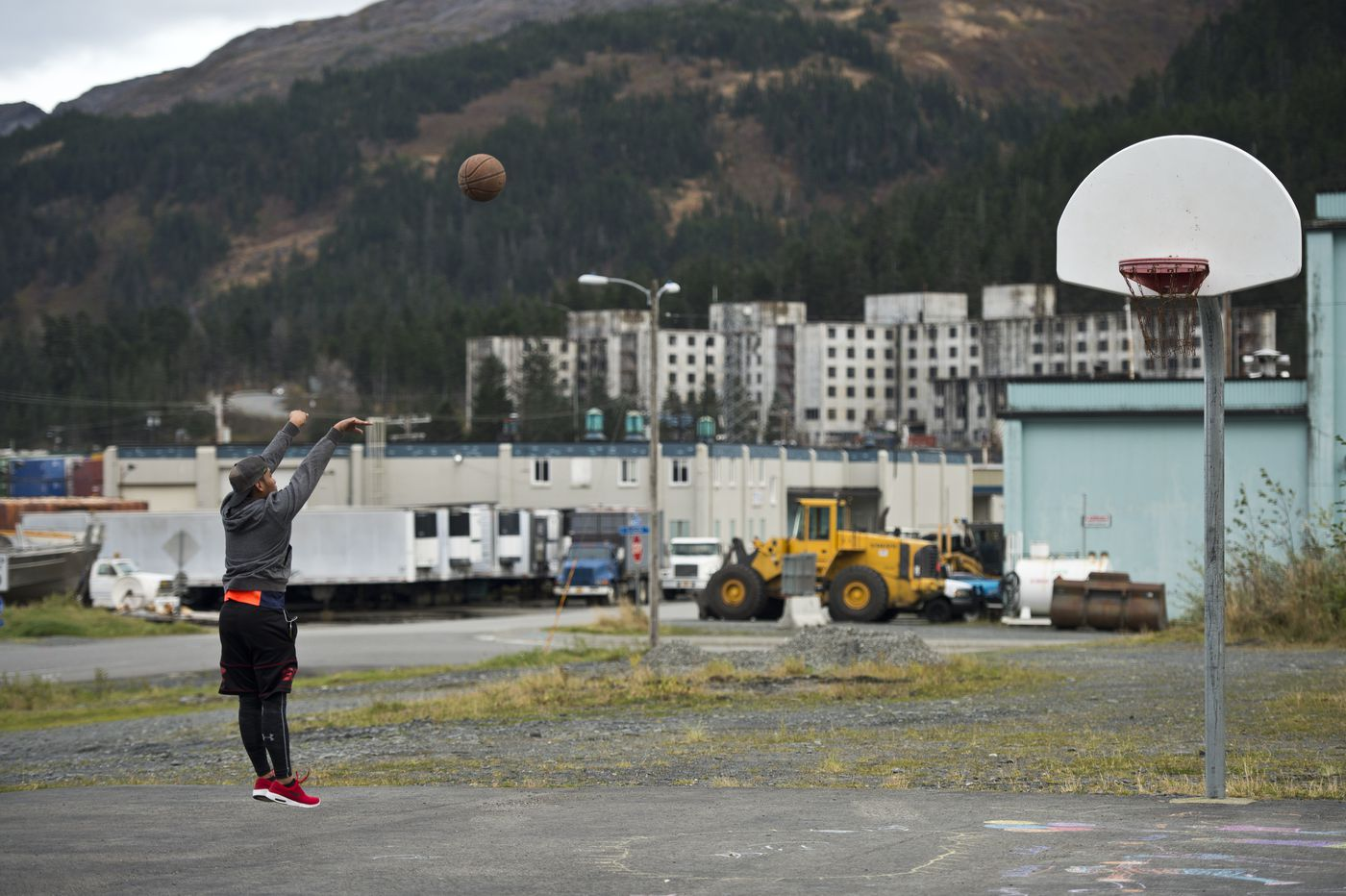 Michaelo Medez, 16, shoots hoops in Whittier on Oct. 10. (Marc Lester / Alaska Dispatch News)