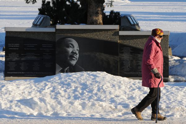 Inngeborg Rathke walks past the Martin Luther King, Jr. Memorial at the Delaney Park Strip near downtown Anchorage on Thursday, Jan. 17, 2019. The annual Martin Luther King, Jr. Community-Wide Celebration hosted by the Martin Luther King Foundation of Alaska is occurring Sunday, Jan. 20, 2019, at the West Anchorage High School auditorium at 3 p.m. (Bill Roth/ ADN)