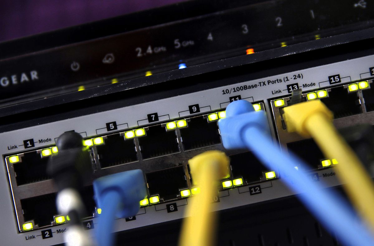 FILE - In this June 19, 2018, file photo, a router and internet switch are displayed in East Derry, N.H. (AP Photo/Charles Krupa, File)